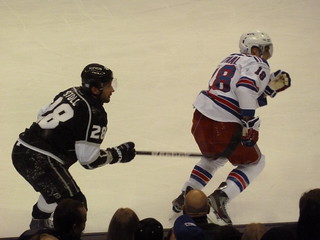 Stoll and Staal Race for the Puck