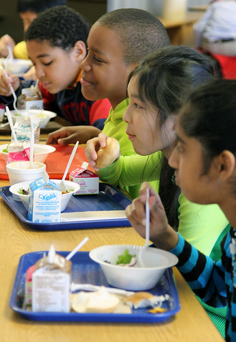 Students at the Wolcott Elementary School in West Hartford, Connecticut enjoying lunchtime