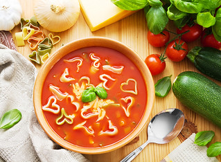 Soup with heart shaped pasta