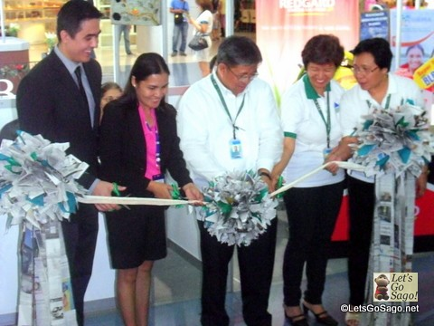 Newspaper Ribbon Cutting for the Eco Fair as part of the Earth Day 2013 Philippines celebrations