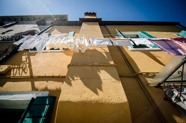 Hanging laundry casts shadows in the Burano sunshine.