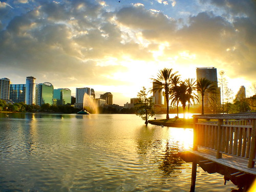 sunset water fountain beautiful clouds palms orlando cityscape florida lakeeola goldenhour