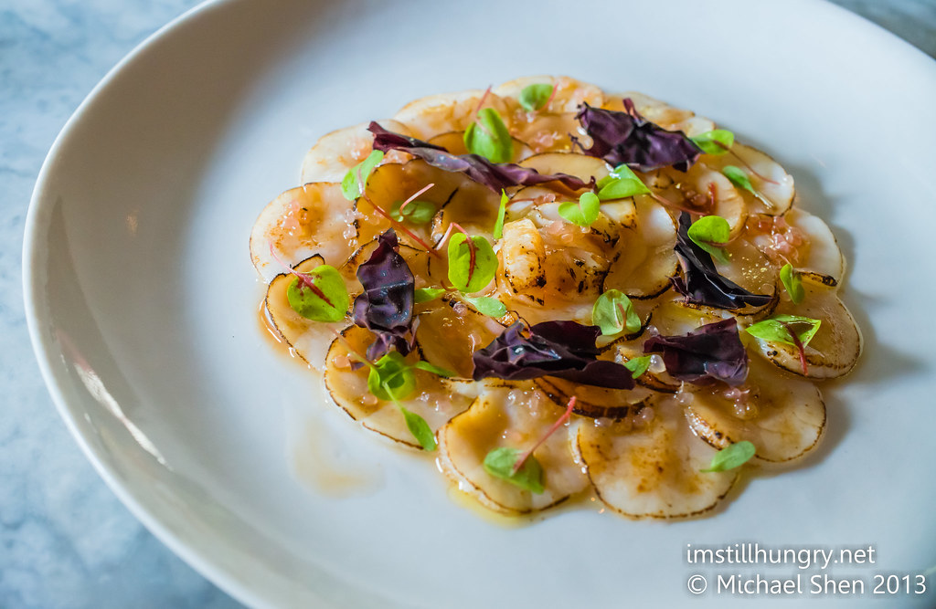 Ume Scallop carpaccio - lightly seared scallops, soy brown butter, finger limes, young sorrel, dulse