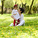 Mother and little girl playing in the park by javi_indy