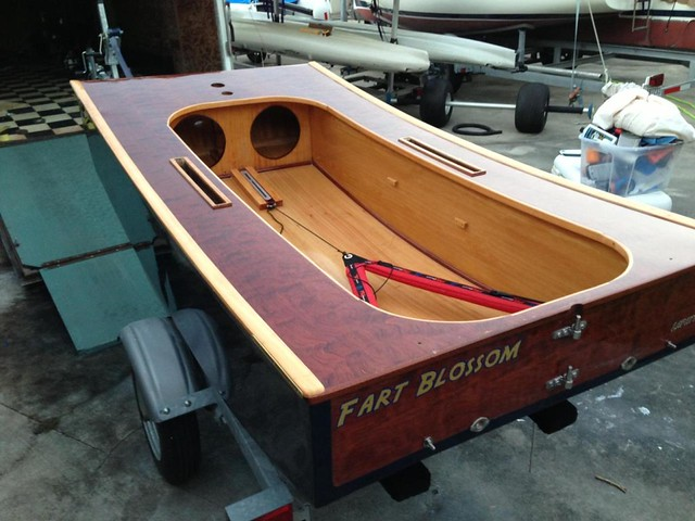 Beautiful varnished OzRacer homebuilt sailboat with lots of clever mods and a windsurfer rig