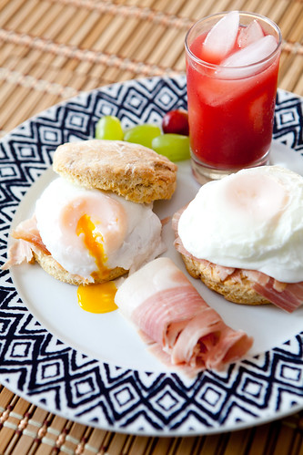 Homemade goose fat biscuits topped with sliced Johnston Country Ham and poached eggs