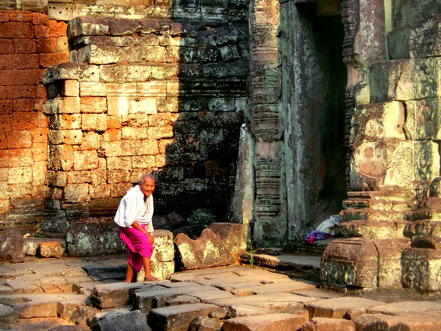 A man strolls the temple grounds at the temples of Angkor, Cambodia