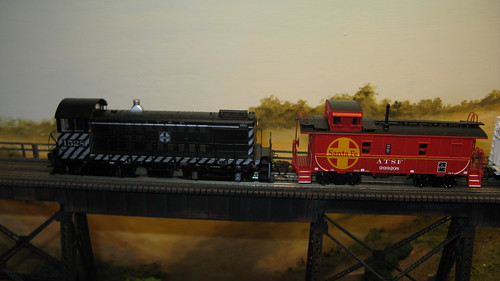 Atchison, Topeka & Santa Fe Railroad switching local crosses a tall steel trestle. by Eddie from Chicago