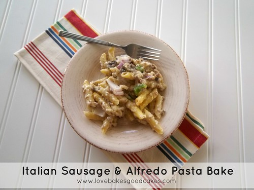 Italian Sausage & Alfredo Pasta Bake in bowl with fork.