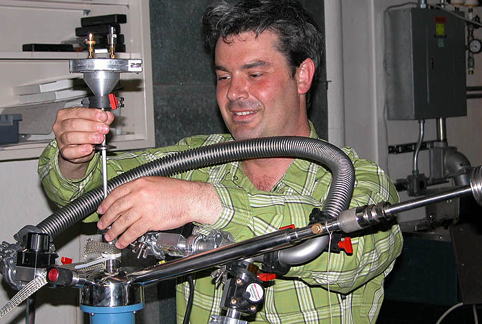 Arkady Shekhter setting up the resonant ultrasound measurement in a flow cryostat.