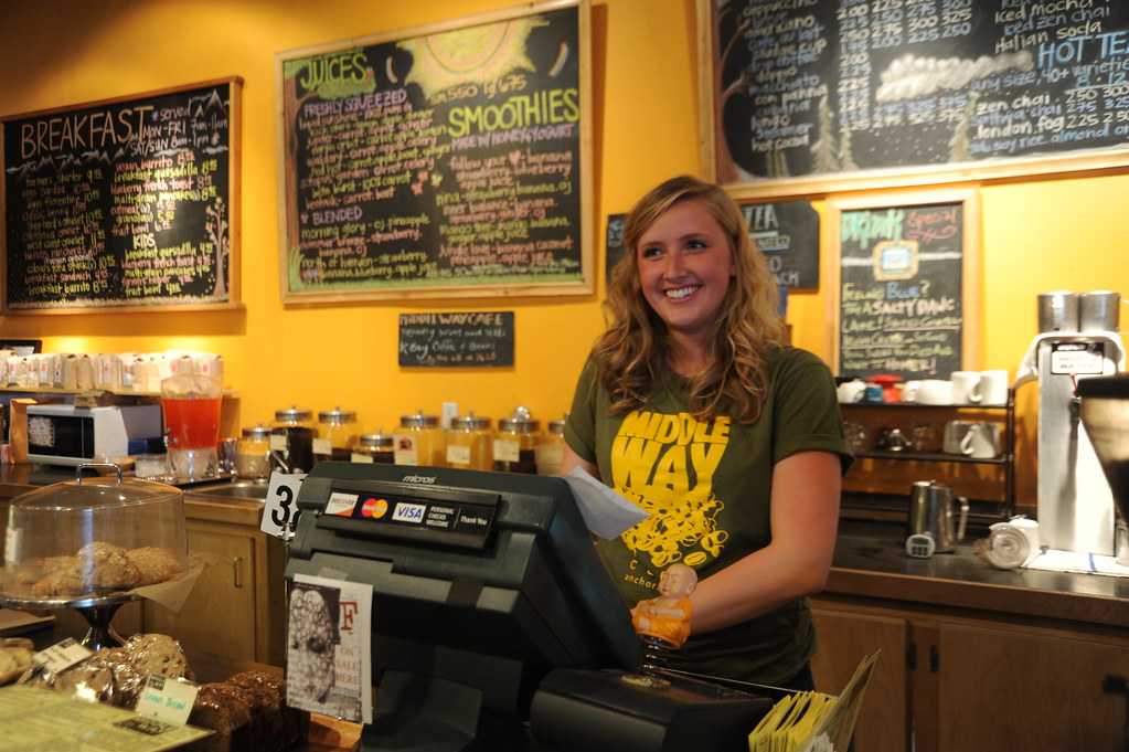 Our smiling hostess, Middle Way Cafe, Buddhist coffee house and restaurant, menus, t-shirt, Northern Lights Boulevard, Anchorage, Alaska, USA