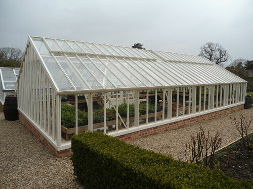 Greys Court greenhouse- lovely styled setting which complements shape of greenhouse