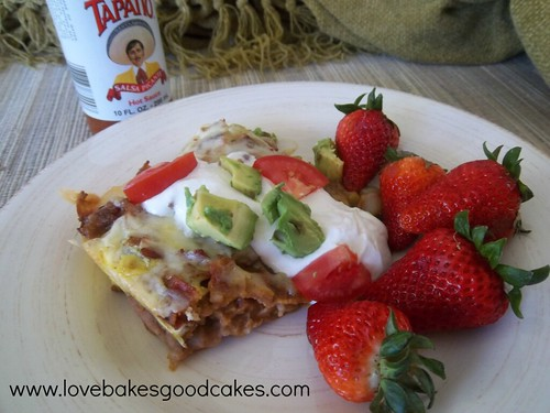 Mexican Breakfast Casserole on plate with strawberries.