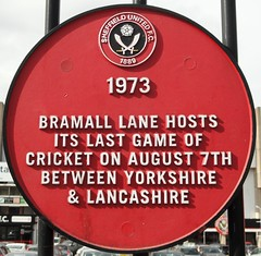 Photo of Yorkshire County Cricket Club and Lancashire County Cricket Club red plaque