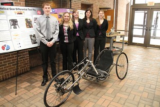 Hand-Crank Cycle Integration Team with poster and hand-crank cycle