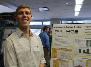 Automated Sealant System Team member with poster