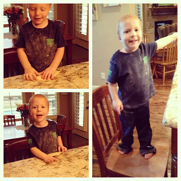 Helping make pizza. Covered in flour. Why do I even dress him somedays???
