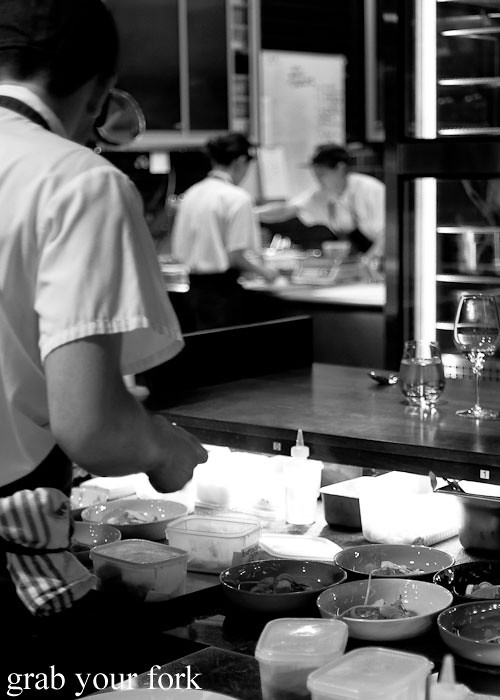 chefs in open kitchen at momofuku seiobo the star sydney