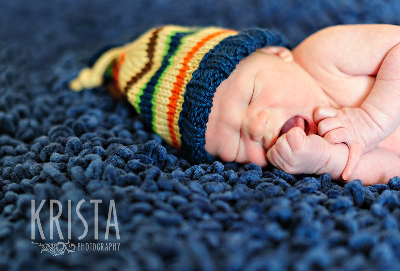 newborn baby boy in knit hat