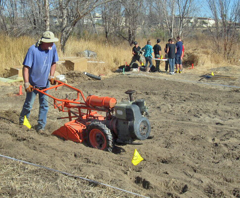 Ken Lair operates a rototiller at one of his field trials. (Photo courtesy Jackie Lindgren)
