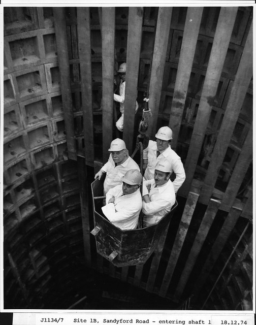 Men entering a Metro Shaft