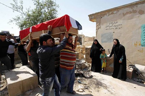 A bombing victim, Bashar Muhsin, 28, is taken for burial in Najaf, 100 miles (160 kilometers) south of Baghdad, Iraq, Monday, April. 29, 2013. Five car bombs exploded Monday in predominantly Shiite cities and districts in central and southern Iraq. by Pan-African News Wire File Photos