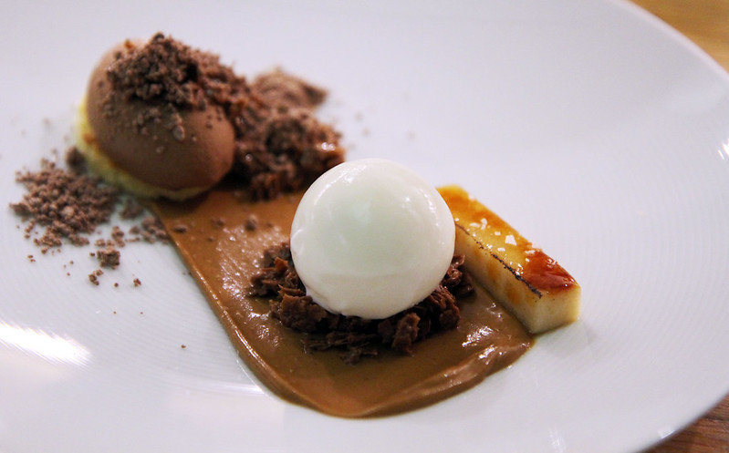 Gianduja Mousse, toasted orange pound cake, banana brûlée, nutella powder, frozen Greek yogurt