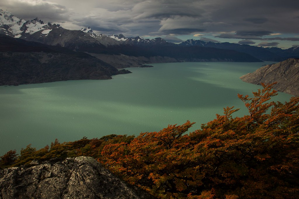 Dark clouds gather and strong winds blow over the southwestern arm of the 1000 km² Lago O'Higgins in Deep Patagonia, Aysen, Chile. Its turquoise melting waters from the Southen Patagonian Ice Cap, drain to the Pacific through the threatened Rio Pascua. Notice the waves on the lake.