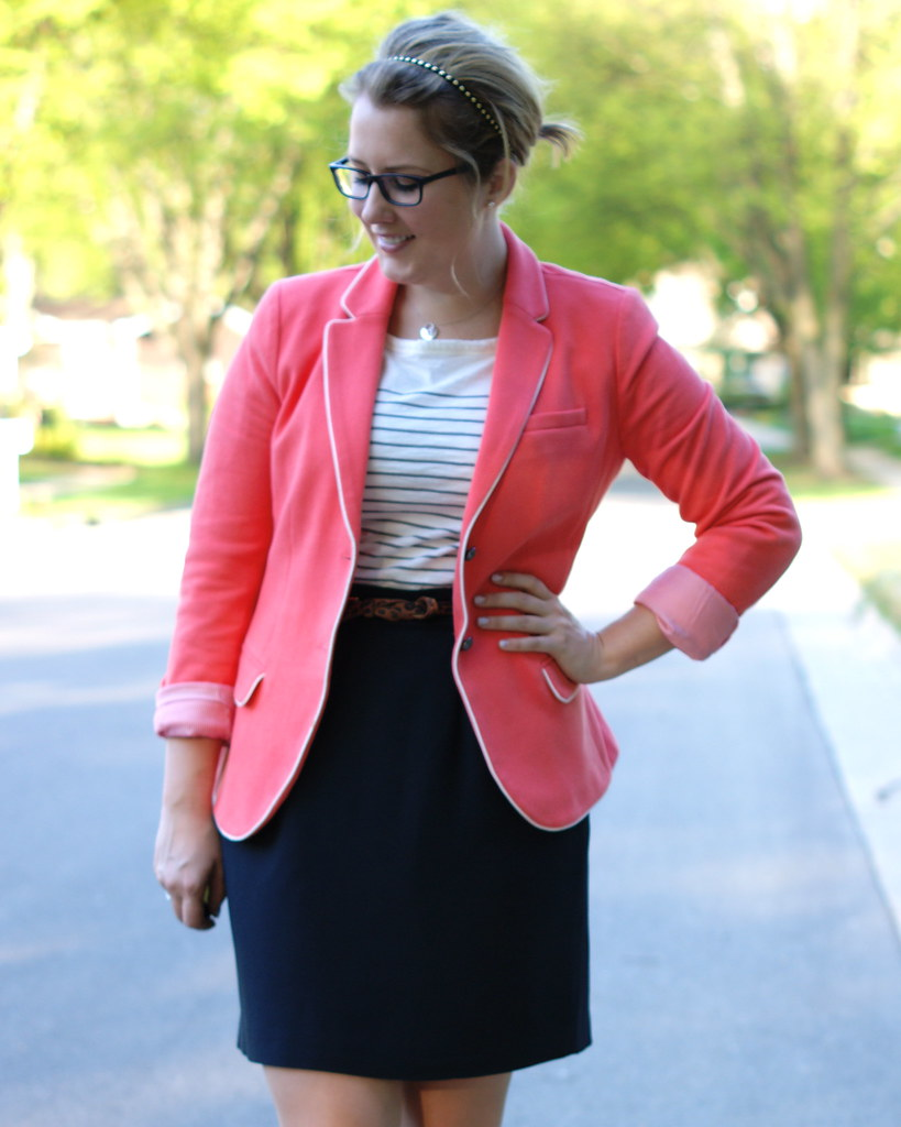 coral blazer with a black skirt