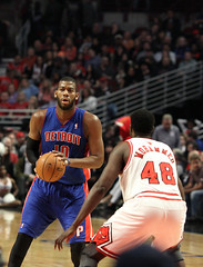 Detroit Piston Greg Monroe guarded by Chicago Bull Nazr Mohammed