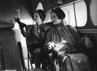 Models posing inside a Qantas aircraft, Queensland, 1936