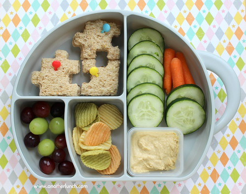 fun preschool lunch with puzzle sandwich, grapes, hummus, cucumbers and veggie chips