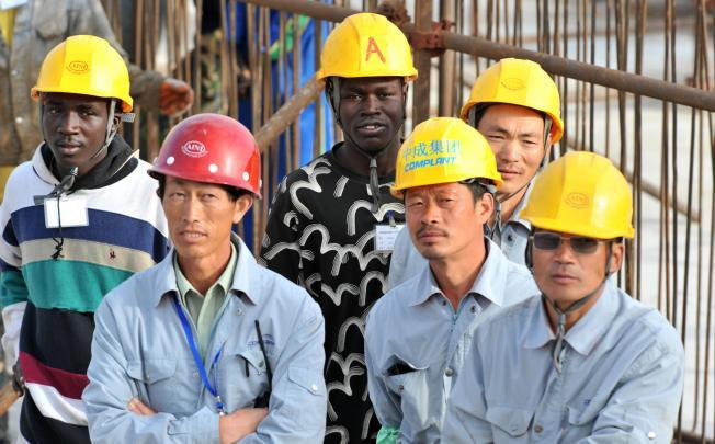 Chinese and Senegalese workers
