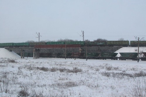Coal trains cross paths outside the city of  Красноармі́йськ (Krasnoarmiisk)