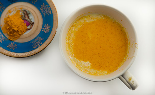 Turmeric  (Curcuma longa) powder and yellow milk.