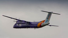 FlyBe Dash-8 rocketing out of Amsterdam for Birmingham