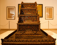 altar(0.0), temple(0.0), throne(0.0), tourist attraction(1.0), carving(1.0), wood(1.0), flooring(1.0),
