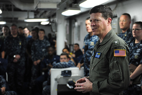 Rear Adm. Mike White, commander of Carrier Strike Group (CSG) 11 speaks with Sailors aboard USS Princeton
