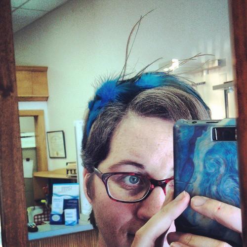 Feathery headband.