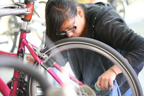 Teen practices bike maintenance at Santa Cruz Bike church