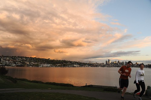 Pink and gray storm edge, clouds, blue sky, reflection in Lake Union, joggers, as seen from Gasworks Park, Capitol Hill, City of Seattle, Washington, USA by Wonderlane