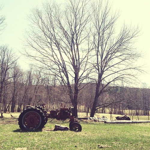 Oh you know, just another little farmhouse with a vintage tractor sitting out front. NBD.