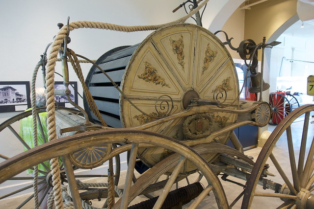 Hand-pulled hose wagon.
