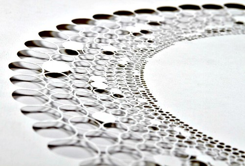 detail of finely cut paper circles