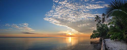 Sunrise panorama from Wakatobi by Nathalie Stravers