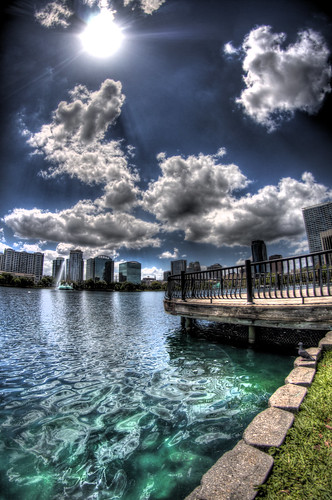 sky sun lake water scrapers orlando dock downtown florida teal eola
