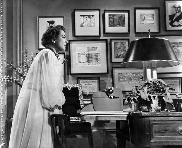 Joan Crawford adorned in a demure costume Peignoir Robe in SUDDEN FEAR 1952