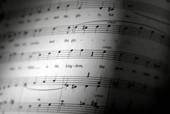 sheet music(1.0), line(1.0), monochrome photography(1.0), close-up(1.0), circle(1.0), monochrome(1.0), black-and-white(1.0),
