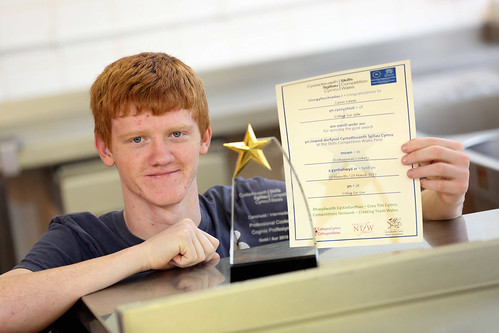Lewis Lane, winner of the professional cookery 2013 competition, holding his certificate and trophy