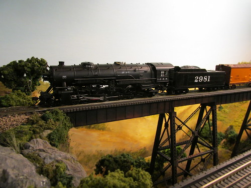An Illinois Central Railroad steam powered freight train crossing the tall steel trestle.  The Oak Park Society of Model Engineers,H.O Scale Model Railroad Club.  Oak Park Illinois.  July 2013. by Eddie from Chicago